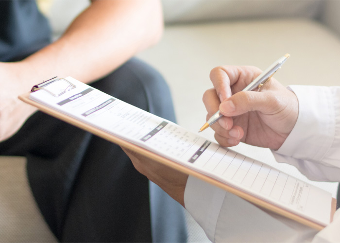 practitioner filling out a screening form