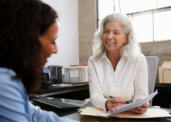 older practitioner talking to a client
